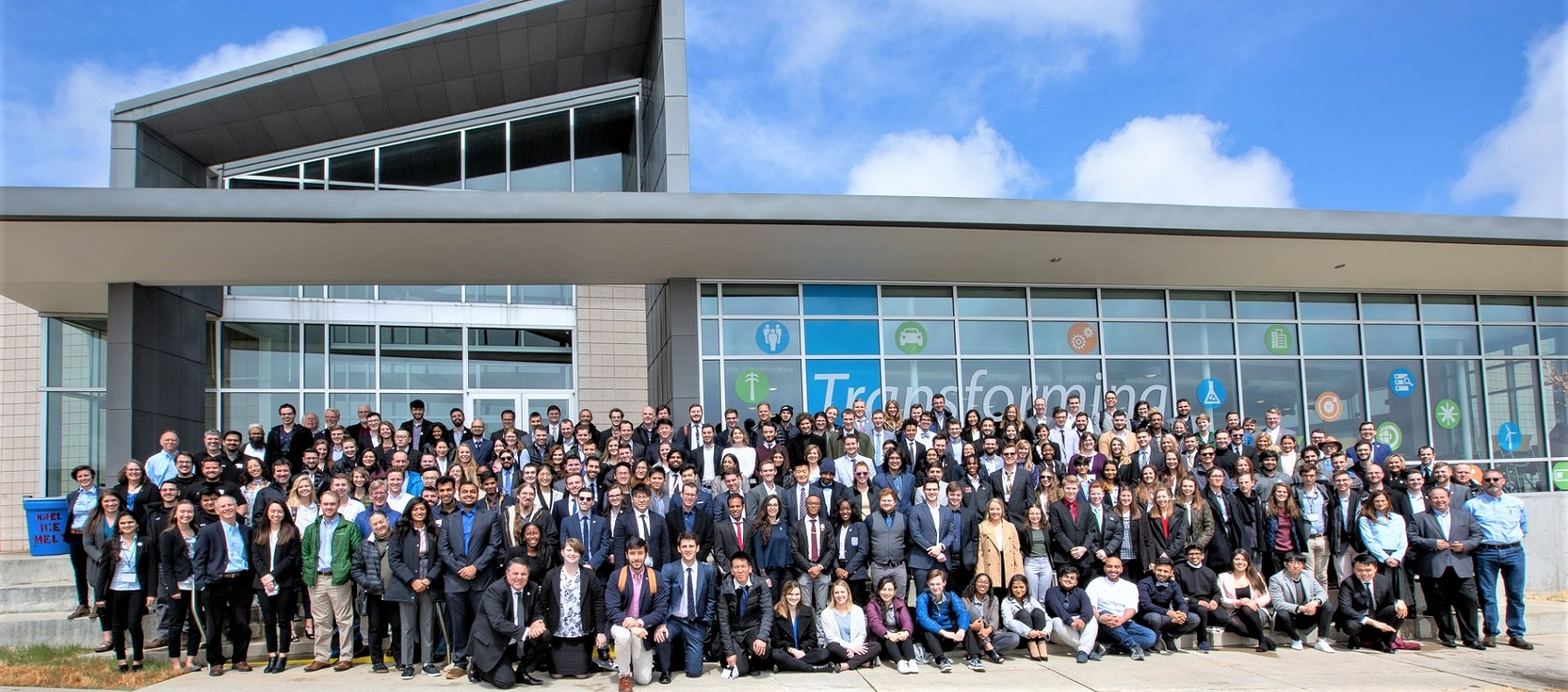 Photo of about 100 participants at the U.S. Department of Energy Solar Decathlon.