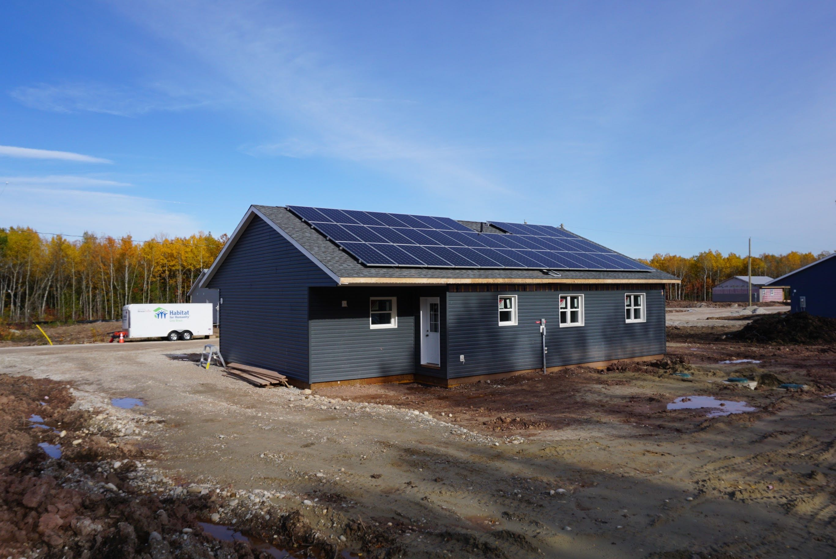 Photo of a newly constructed home with solar panels on the roof.