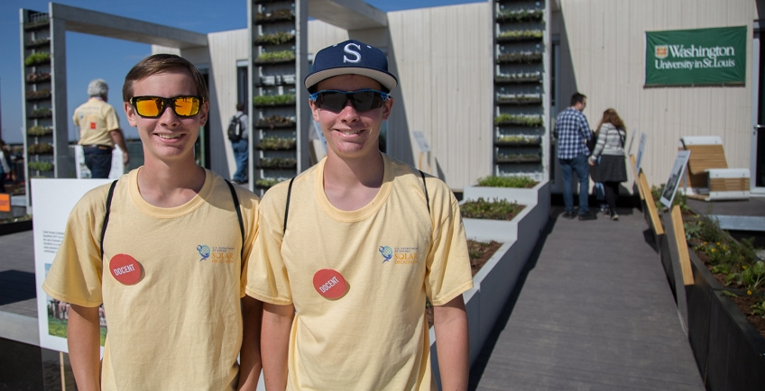 Photo of a two volunteers in yellow t-shirts.