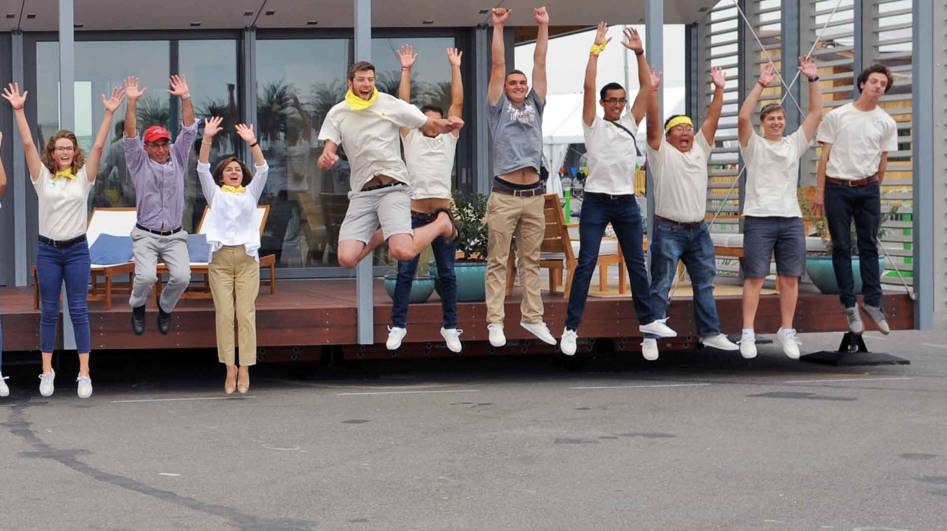 Photo of Stevens students jumping in front of their Solar Decathlon 2015  house.