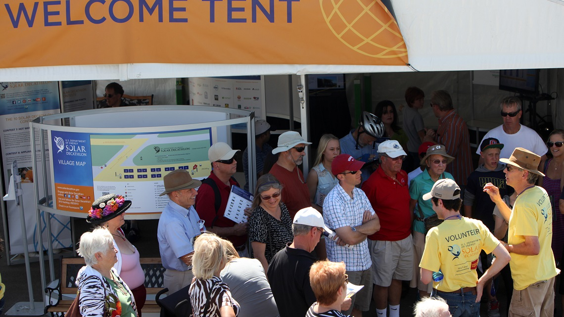 Photo of volunteers for the U.S. Department of Energy Solar Decathlon welcoming visitors.