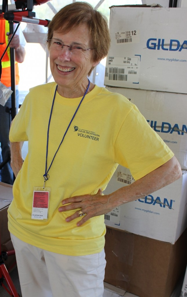 Photo of a woman wearing a volunteer t-shirt.