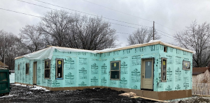 A photo of a house without its siding installed.