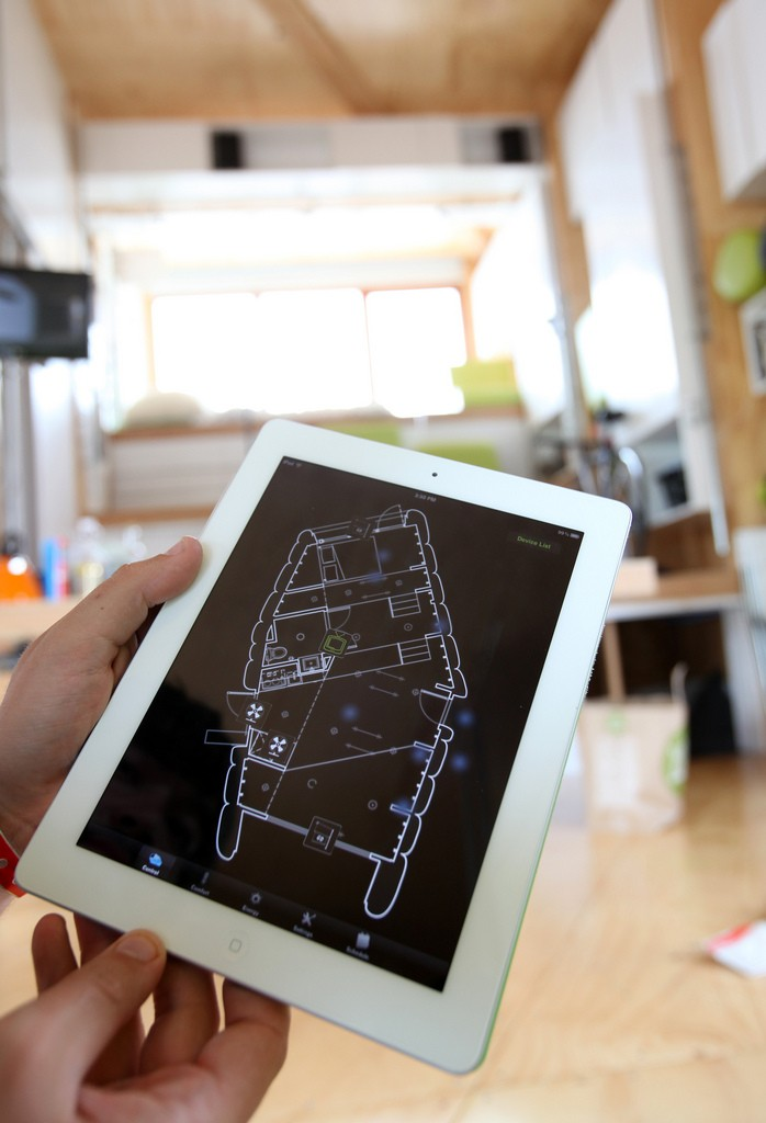 Photo of a house diagram displayed on an iPad.