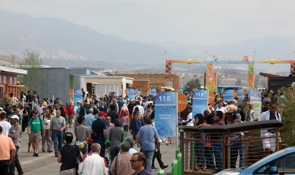 Photo of crowds of visitors within the Solar Decathlon village.