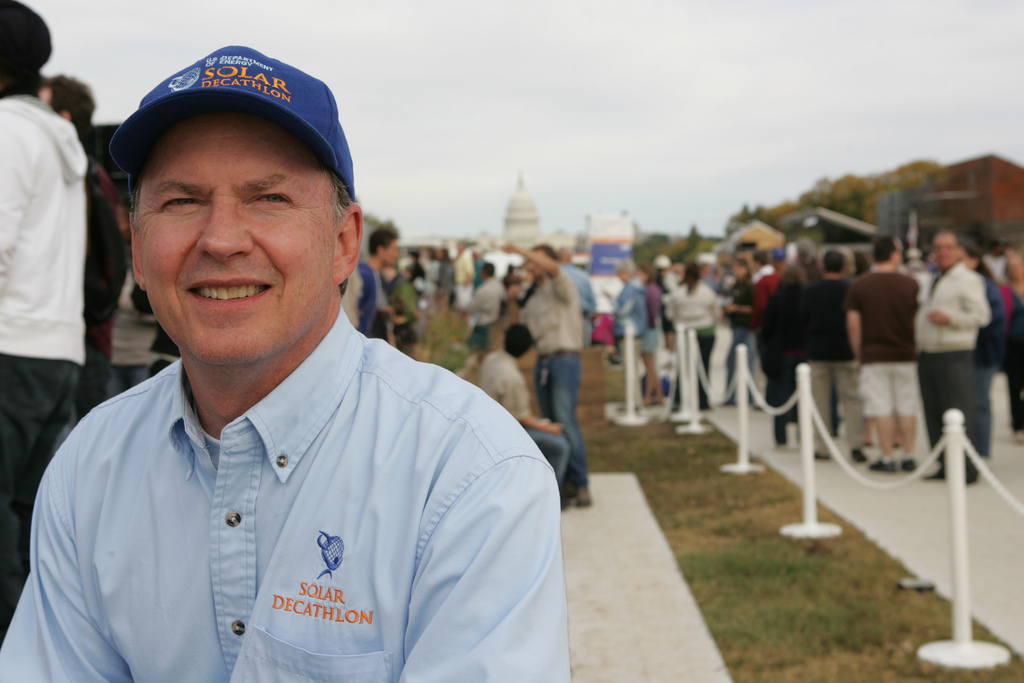 Photo of a man wearing a Solar Decathlon baseball cap.