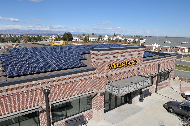 Photo of a Wells Fargo building with solar panels on its roof.
