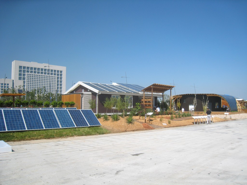Photo of the Australia and Sweden houses. A PV array is in the foreground to the left.