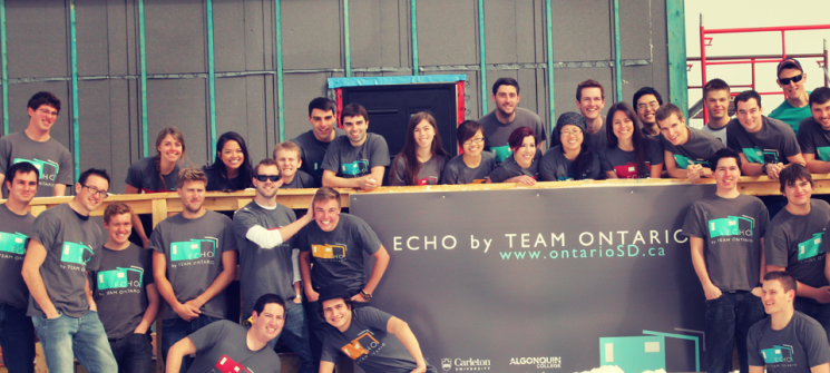 Photo of members of Team Ontario on the deck of their partially constructed house.