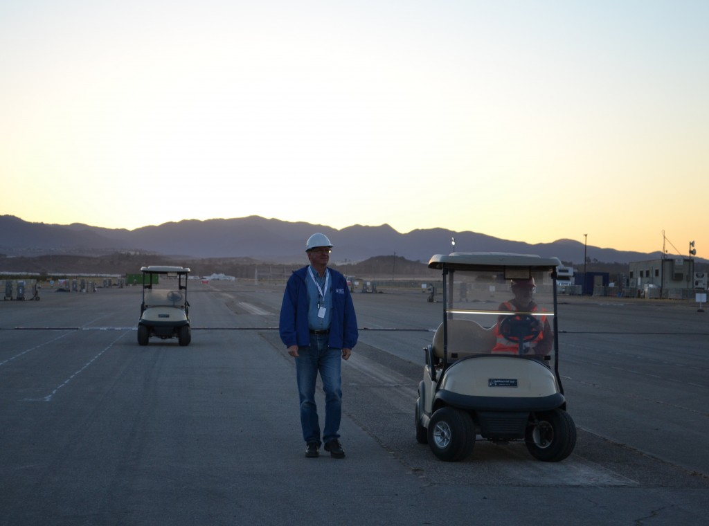 Photo of Richard King with the sun rising in the background.