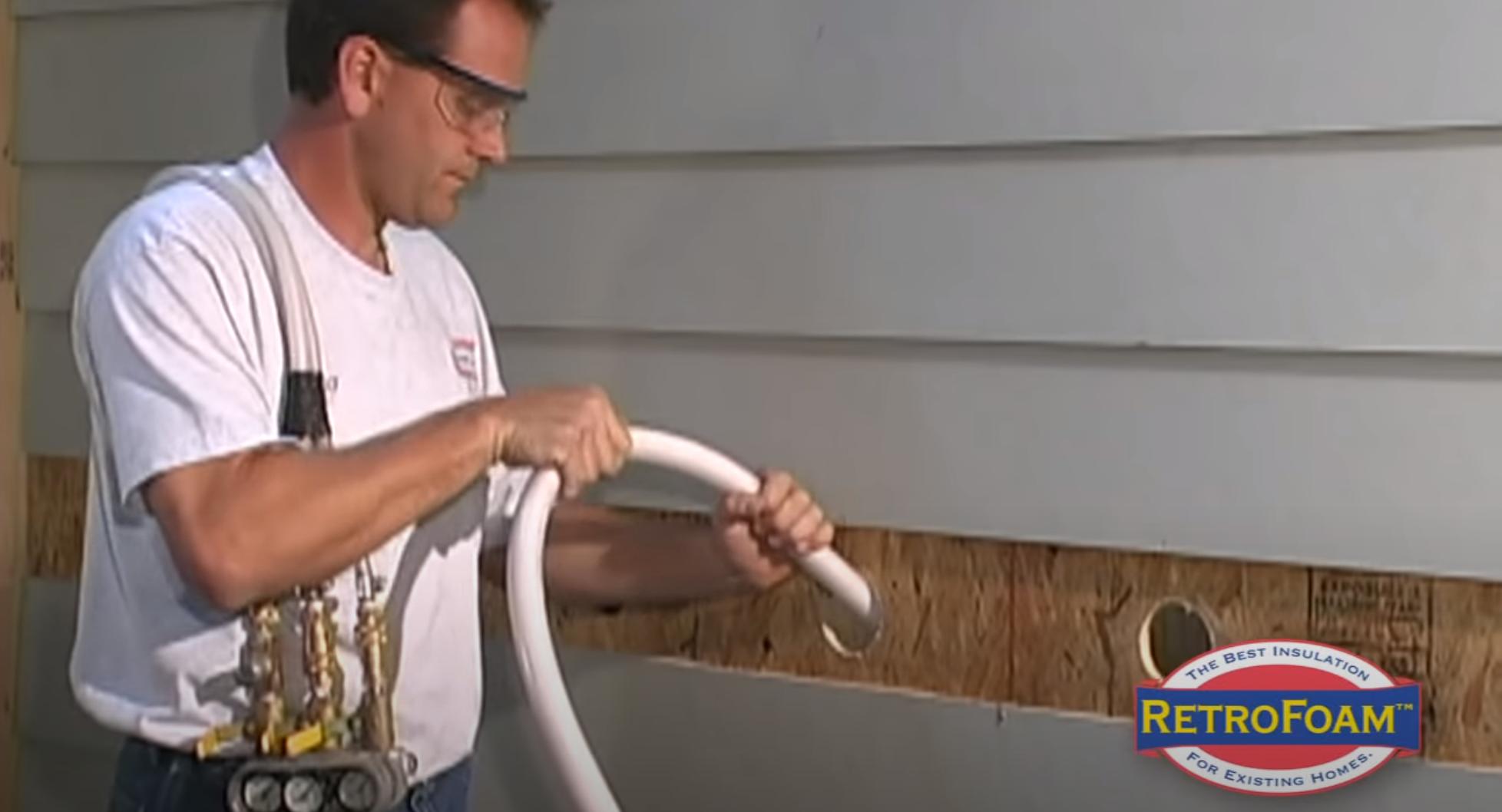 a man conducting a drill-and-fill latex foam system instillation