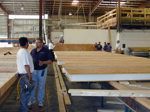 Photo of a warehouse where structural insulated panels are being produced.