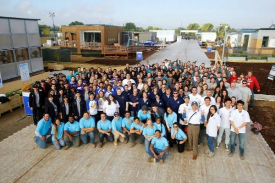 The official all-teams photo for the U.S. Department of Energy Solar Decathlon 2017 at the 61st & Peña Station in Denver, Colorado, October 5, 2017. The competition and public event officially opened today. (Credit: Jack Dempsey/U.S. Department of Energy Solar Decathlon)