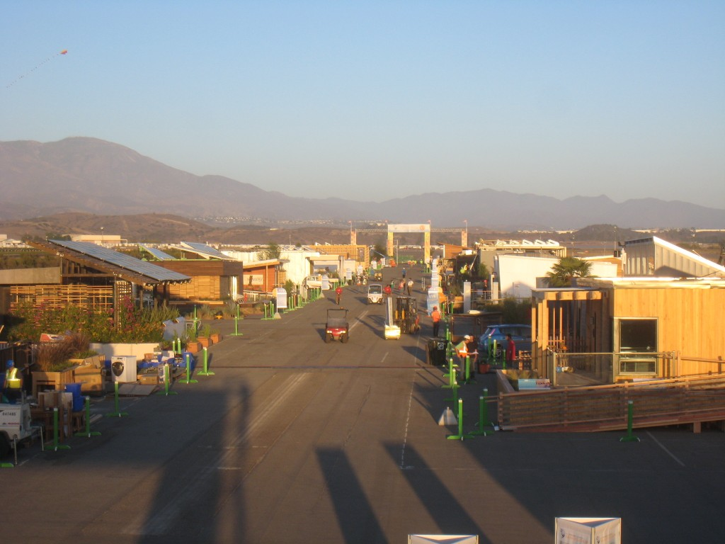 Photo of the Solar Decathlon village near the end of assembly.