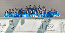 Photo of the Czech Technical University Solar Decathlon  2013 team standing on a balcony marked with graffiti.
