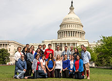 Photo of members of the Catholic University of America,  George Washington University, and American University Solar Decathlon 2013 team  in front of the U.S. Capitol.