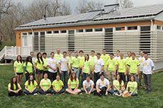 Photo of members of the Missouri University of Science  and Technology Solar Decathlon 2013 team standing in front of a solar-powered  house.