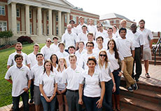 Photo of members of the University of North Carolina at  Charlotte Solar Decathlon 2013 team standing in front of Grigg Hall on campus.