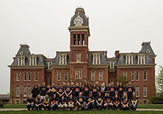 Photo of members of the West Virginia University Solar  Decathlon 2013 team in front of a building on campus.